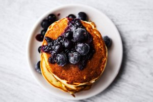 Coconut Gluten-Free Pancakes with Berry Syrup Recipe Image